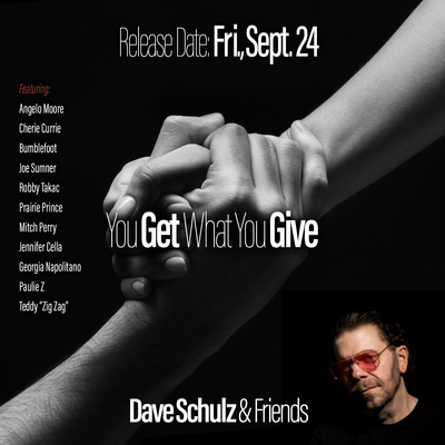 """Read more about the article The Daily Feature: American Musician Dave Schulz Covers 90s Classic """"You Get What You Give"""" With Friends"""